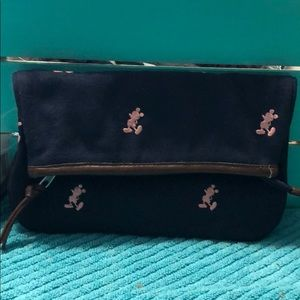 Navy with pink embroidered Mickey Mouse.
